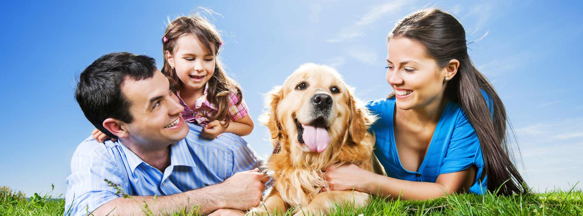 Smiling happy family with Golden Retreiver